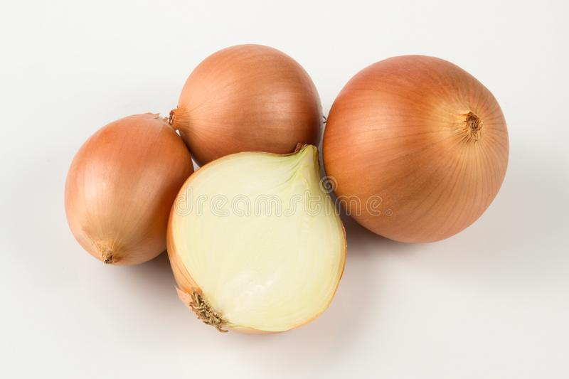 Heap of fresh beige onion bulb on white background. royalty free stock images