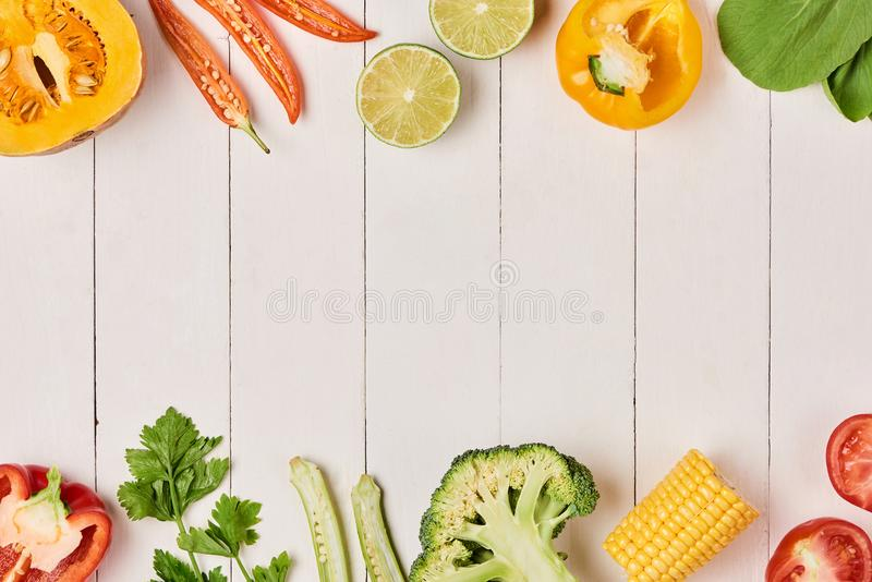 Heap of fresh fruits and vegetables on wooden background stock photography