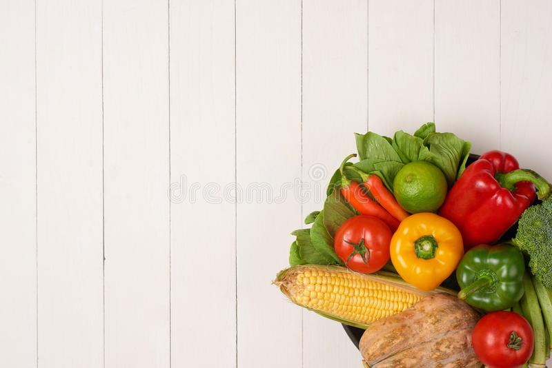 Heap of fresh fruits and vegetables on wooden background stock images