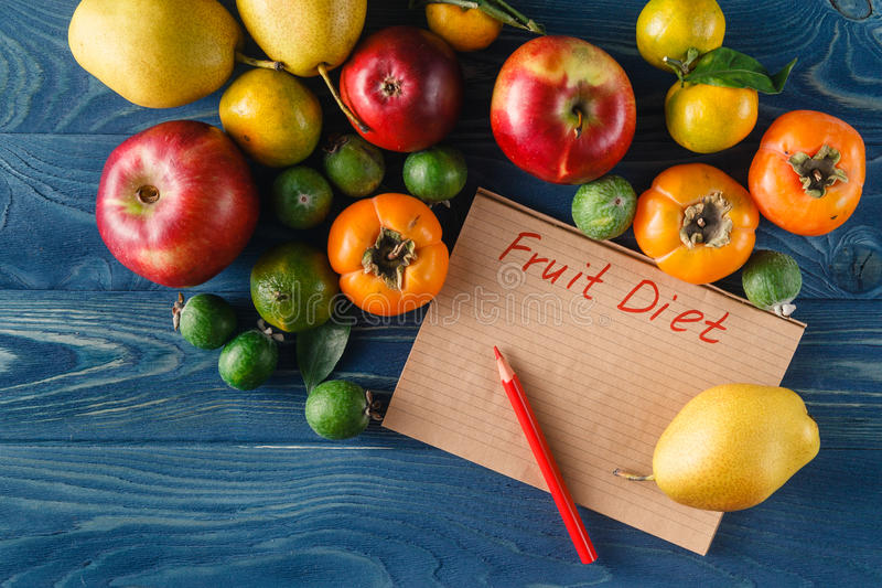 Heap of fresh fruits and vegetables on wooden background stock image