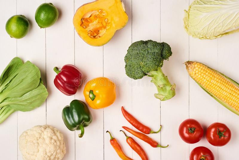 Heap of fresh fruits and vegetables on wooden background stock photos