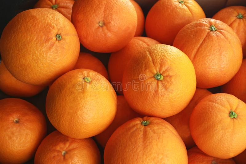 Fresh oranges, close-up, full frame. A heap of fresh oranges, close-up, full frame, background with copy space royalty free stock image