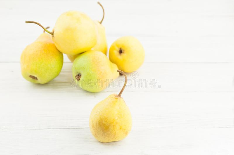 Heap of fresh ripe yellow whole pears and one pear separately stock images