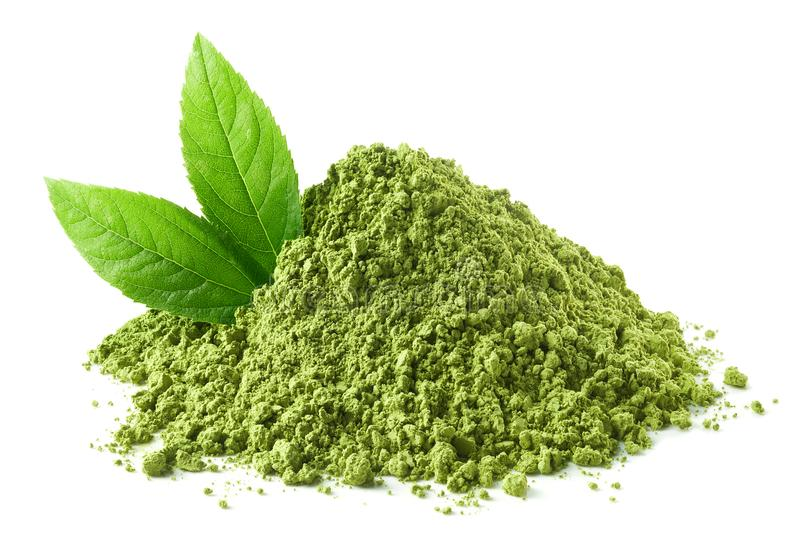 Heap of green matcha tea powder and leaves. Isolated on white background stock photos