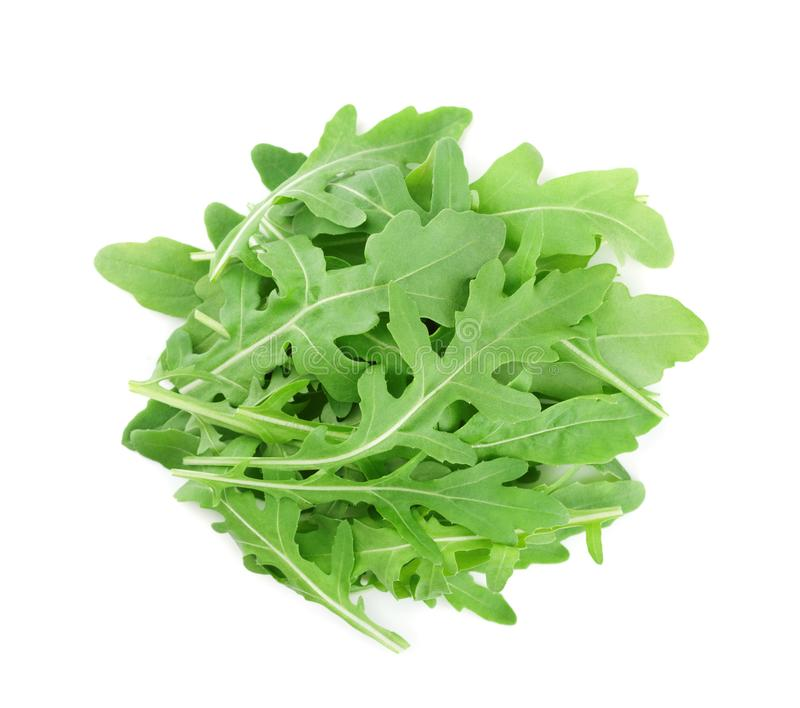 Heap of green rucola, rocket salad or arugula isolated on white background. Top view. Heap of green rucola, rocket salad or arugula isolated on white. Top view royalty free stock image