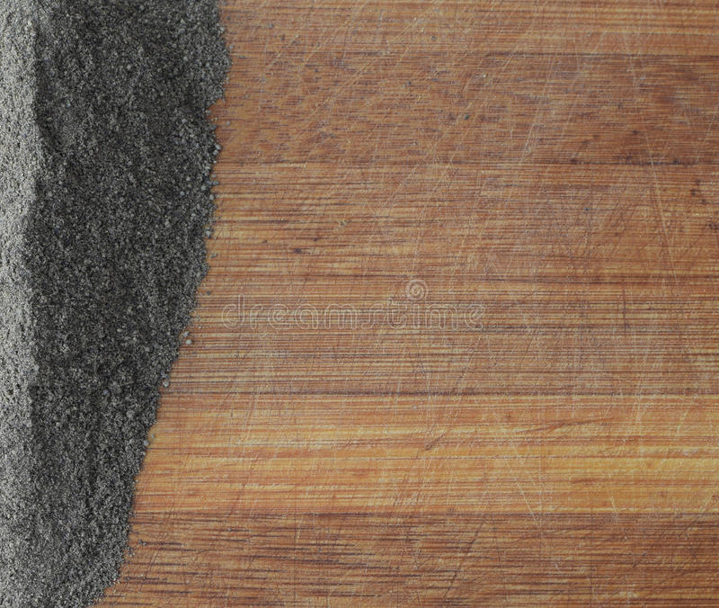 Heap of Ground Black Pepper on Wooden Background. Heap of Ground Black Pepper on Old Wooden Background Top View royalty free stock images