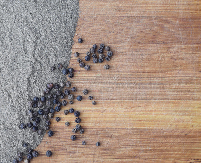Heap of Ground Black Pepper on Wooden Background. Heap of Ground Black Pepper on Old Wooden Background Top View royalty free stock image