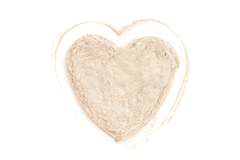 Heap ground White Pepper isolated in heart shape. On white background. Used as a spice in cuisines all over the world royalty free stock photos