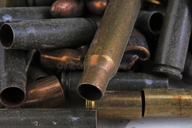 Heap of gun bullets. Weapon Cartridge case sleeve background texture, 7.65, and 9mm. Weapon cartridge sleeves.Gun bullet pattern c royalty free stock image