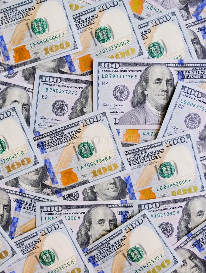 Heap of hundred dollar bills background. USD cash money. Pile of USA banknotes royalty free stock photography
