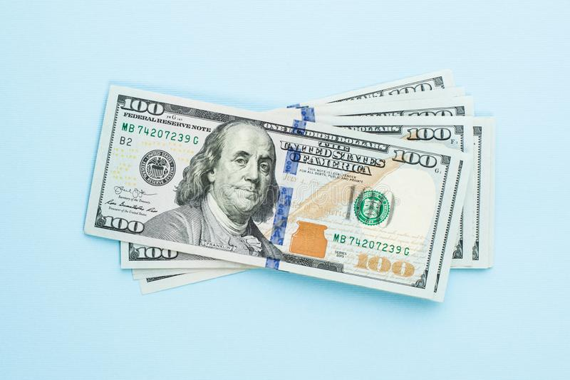 Heap of hundred dollars. Modern 100 us dollar bills on blue background.  royalty free stock photography