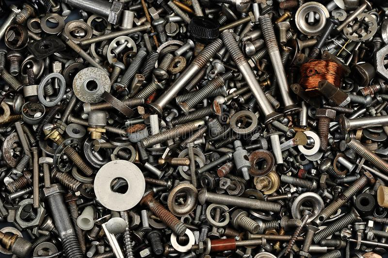 Heap of iron nuts, bolts, details - abstract background royalty free stock photos
