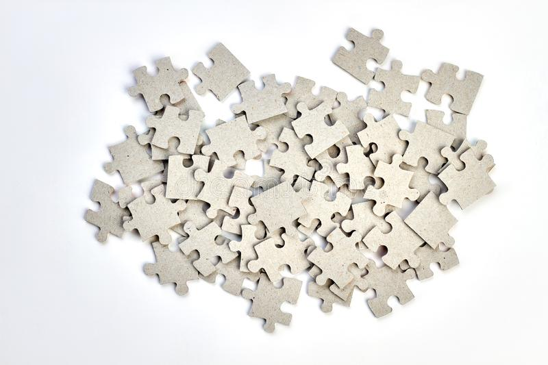 Heap of jigsaw puzzles on white background. Pile of uncompleted puzzles pieces isolated on white royalty free stock images