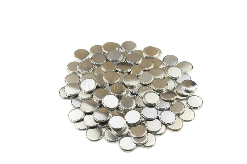 Heap of lithium button cell batteries. Isolated on white background. Closeup stock images
