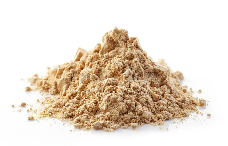 Heap of maca powder. Isolated on white royalty free stock image