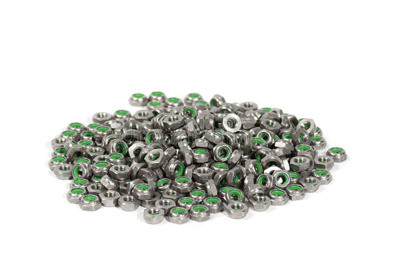 Heap Of Metal Nuts With Green Interior, Stacked, Isolated On White Royalty Free Stock Photo