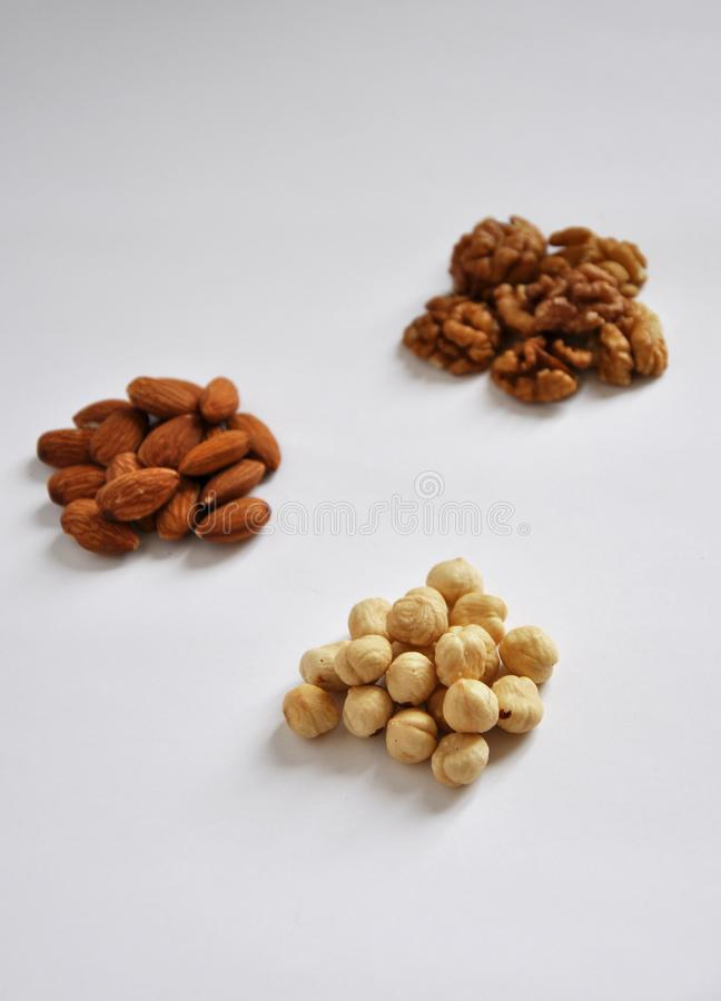 Heap of mixed nuts on white background stock image