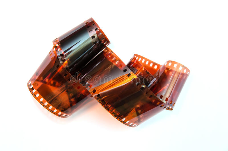 Heap of 35 mm film. Isolated on white background stock photos