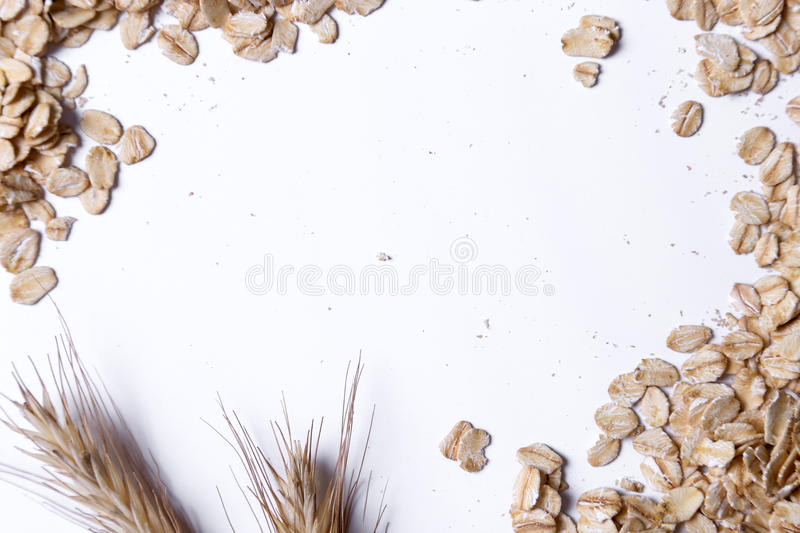 Heap of oats. Food. Oatmeal on the table royalty free stock images