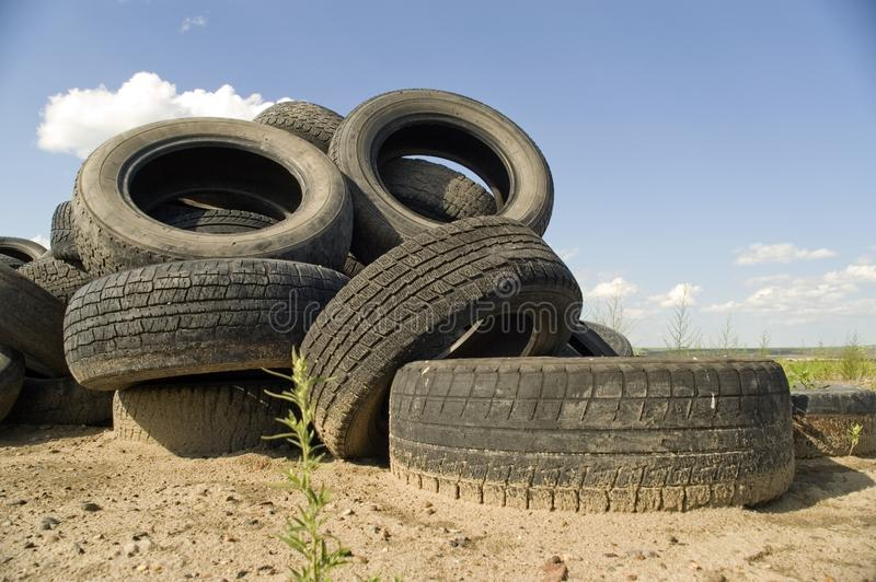 Heap of the old worn out automobile tyre covers. stock images