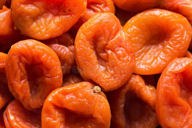 Heap of organic sun dried fruits dehydrated apricots. Healthy diet wholefoods vegan concept. Creative food poster royalty free stock images