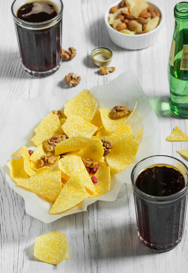 Heap of Paprika Potato Chips on rustic background royalty free stock photography