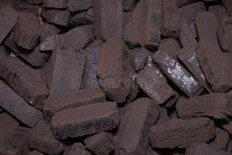 Heap of peat briquettes, alternative fuels, raw material stock photography