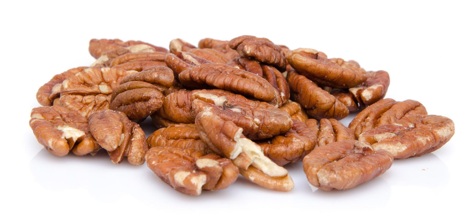 Heap of pecan nuts. Isolated on white royalty free stock photo