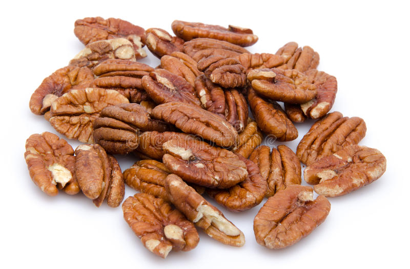 Heap of pecan nuts. Isolated on white royalty free stock image