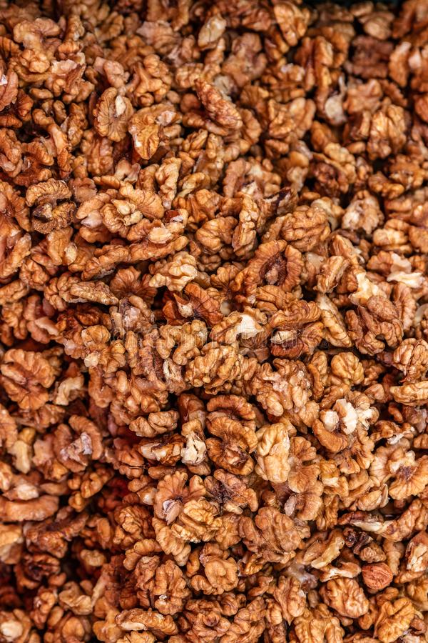 Heap of peeled and chopped walnut without shell for background texture, close-up, top view, copy space for text stock photos