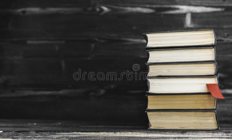 Heap pile of rare books. Open book, hardback books on wooden table. Education background. Back to school. Copy space for text. royalty free stock photography