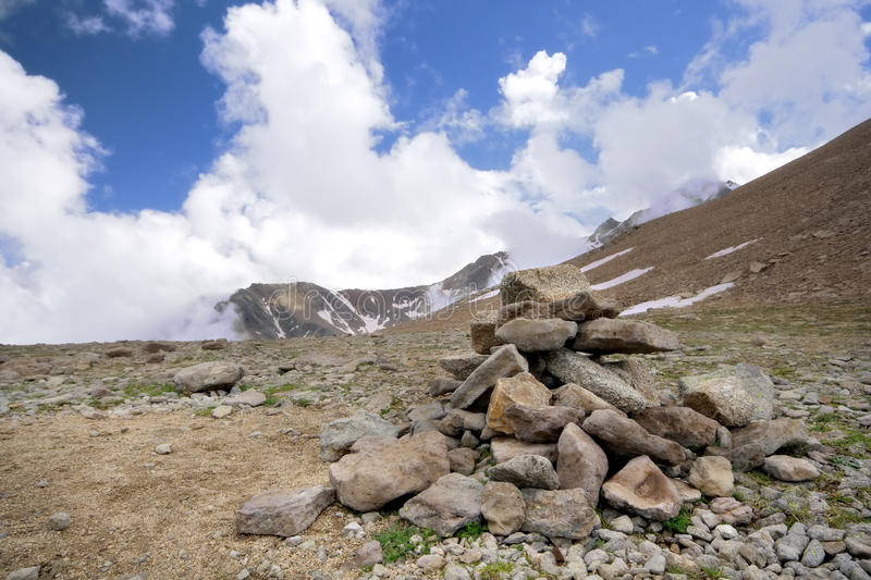 Download Heap (pyramid) Of Stones,Caucasus Mountains,clouds Stock Image - Image: 12888431