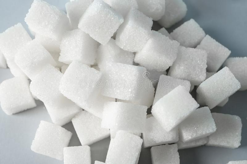 Heap of refined sugar cubes on table, closeup royalty free stock photo