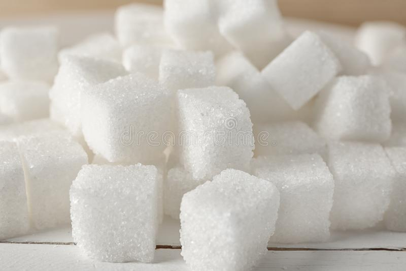 Heap of refined sugar cubes on table, closeup royalty free stock photography