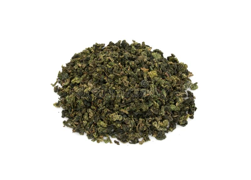 Heap of Rolled leaves of Chinese Oolong green tea isolated on white background royalty free stock images
