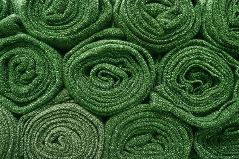Heap of rolled up olive green blankets for background stock photo