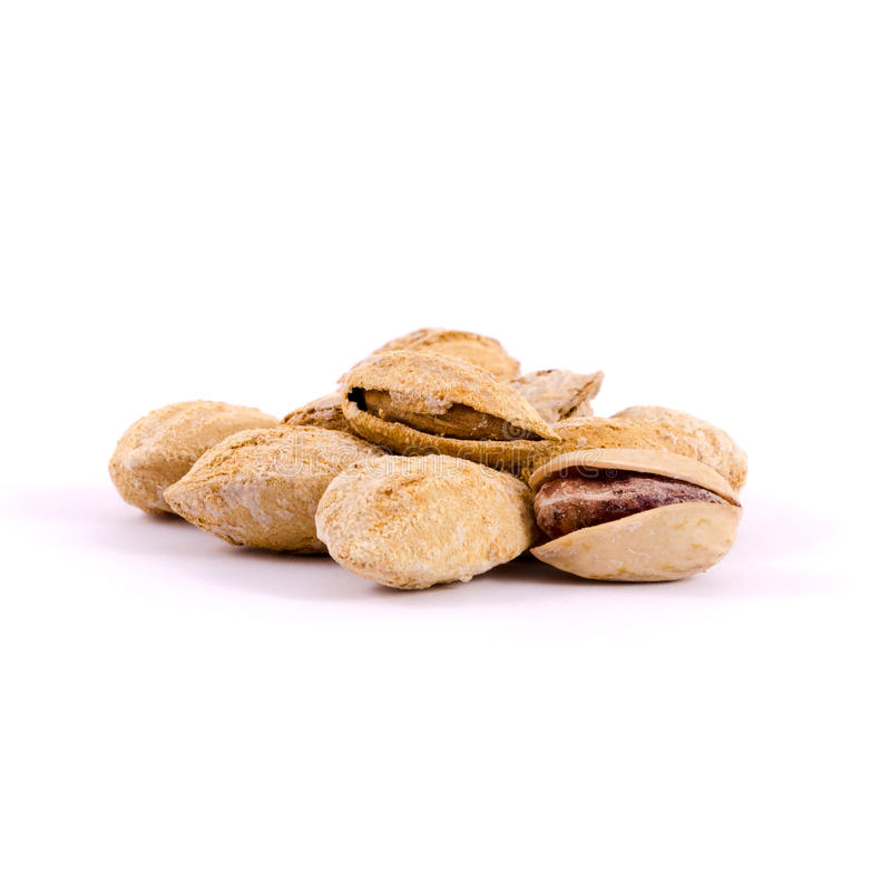 Heap of salted pistachio nuts royalty free stock image