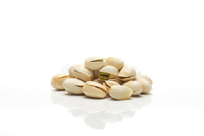 Heap of salted pistachio nuts stock photo