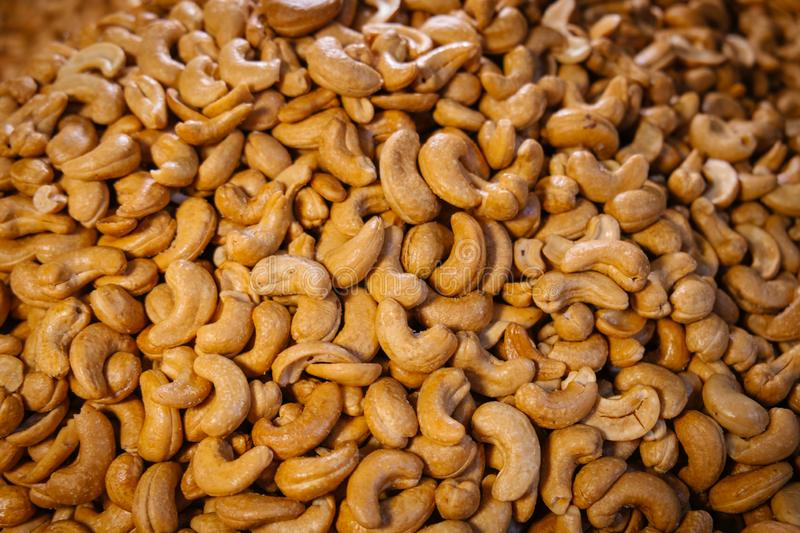 Heap of salted roasted cashew nuts stock photography