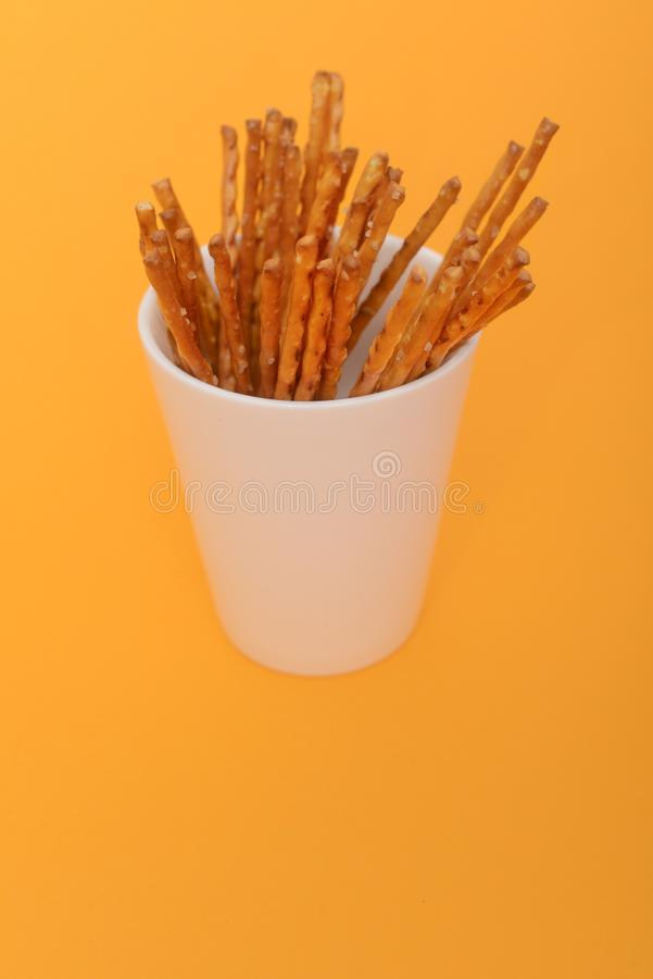 Heap of salted sticks in white cup royalty free stock photos