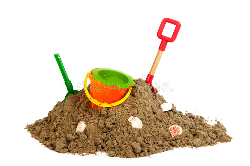 Heap sand with plastic toys at the beach