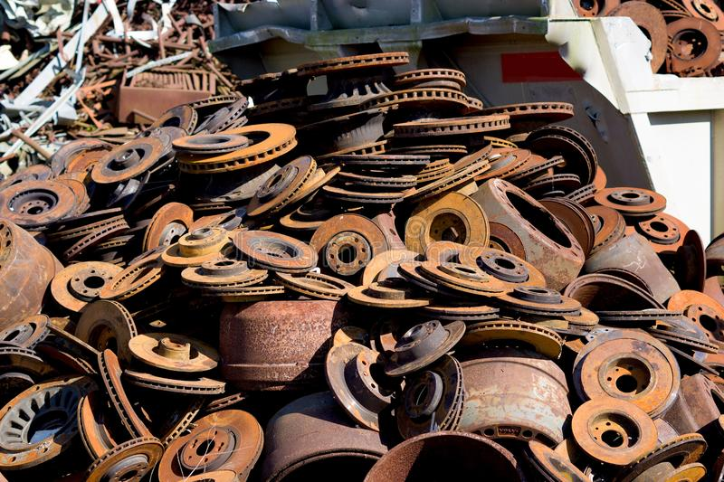 Heap of scrap brake discs stored for recycling stock photos