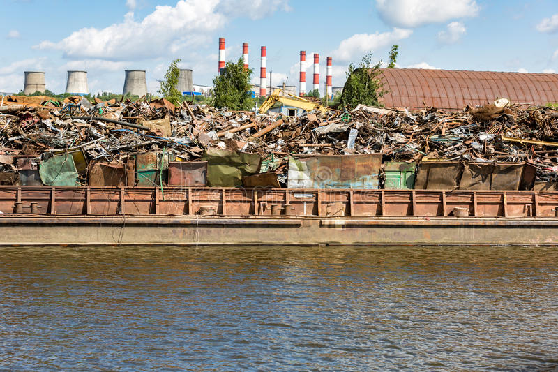 Heap of scrap metal on the river bank royalty free stock photo