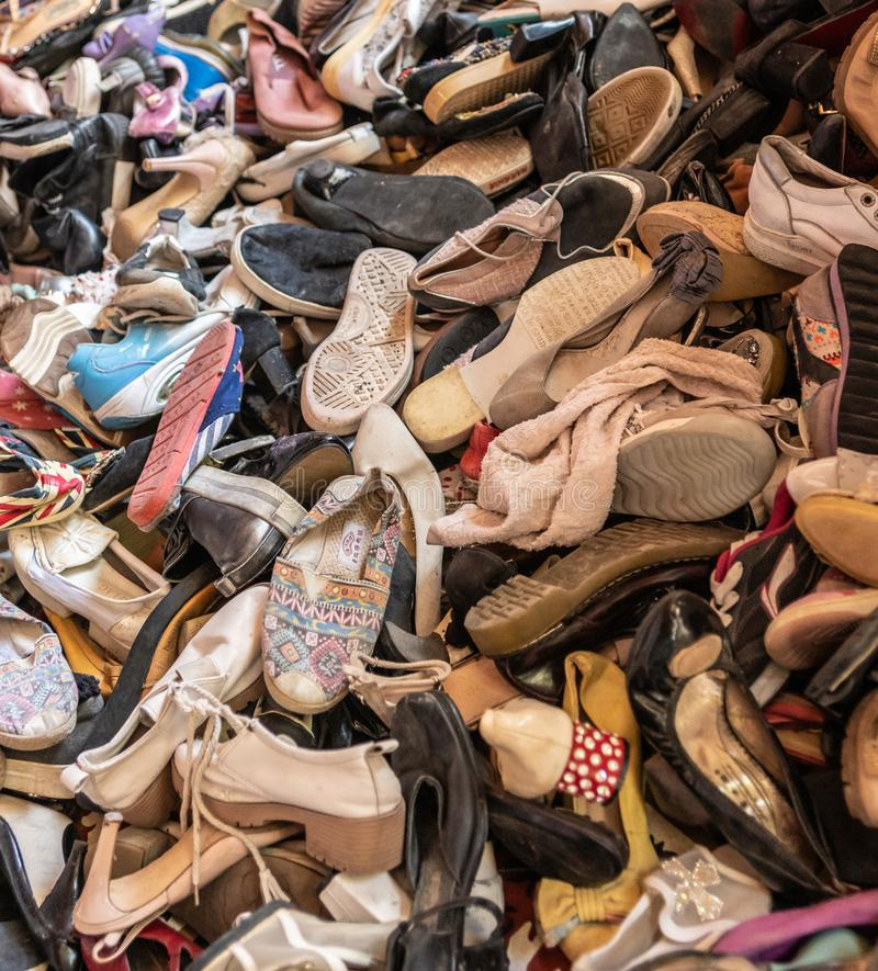 Heap of second hand shoes at Endeqal clothing booth, Balabag, Boracay, Philippines. Balabag, Boracay Island, Philippines - March 4, 2019: Closeup of heap of royalty free stock photos