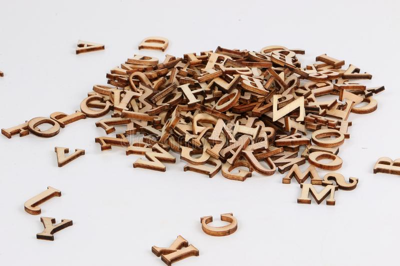 Heap of small wooden letters in the white studio stock images