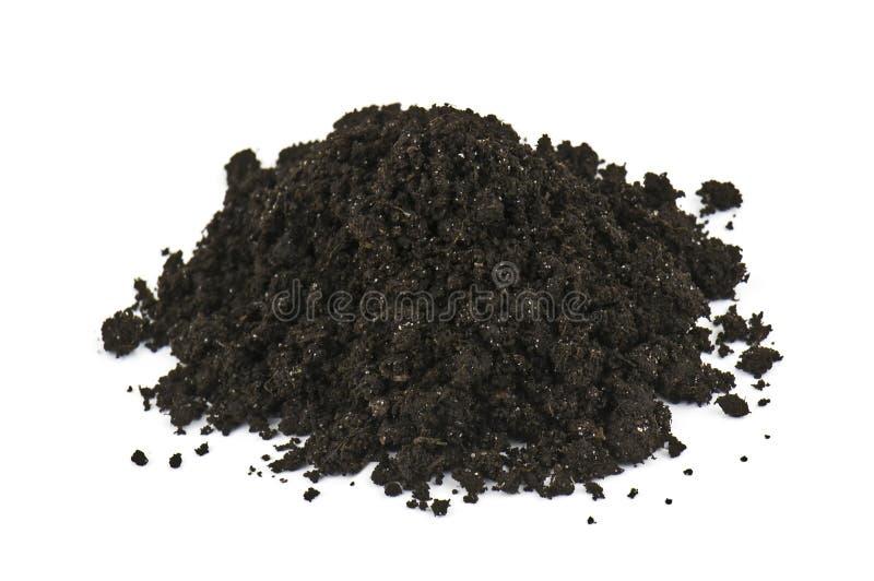 Heap of soil. On white background royalty free stock photos