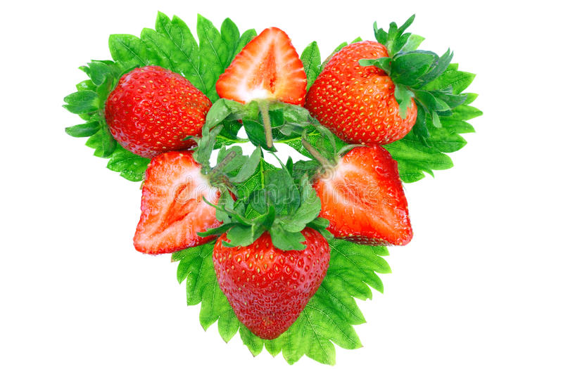 A Heap Of Strawberries On Green Foliage. Isolated Stock Photo