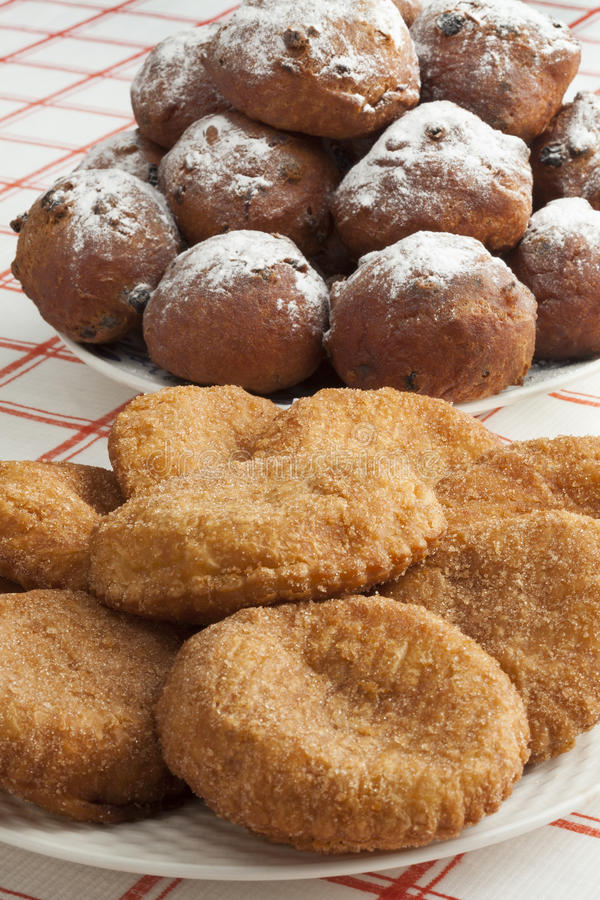 Heap of sugared fried fritters called oliebollen and appelflapp royalty free stock photo