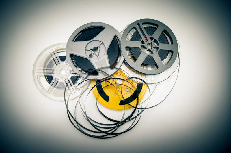 Heap of super 8 mm movie reels, old condition vintage effect. Heap of super 8 mm movie reels different colors, old condition objects and vintage color effect royalty free stock image