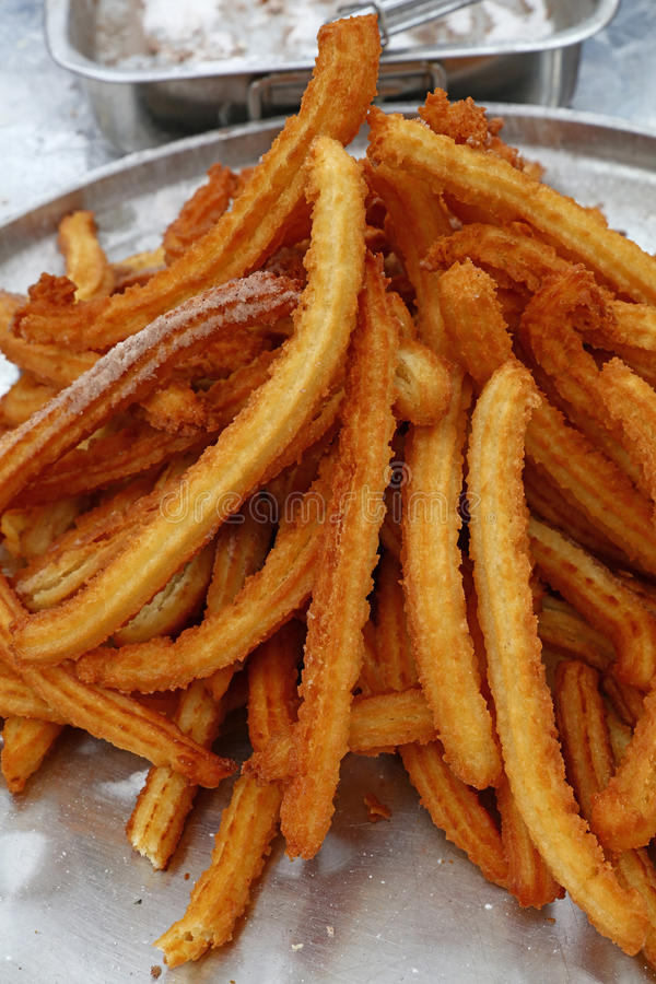 Heap of sweet fresh churros snack close up royalty free stock photo